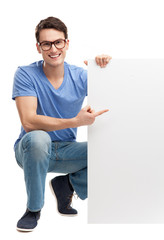 Young man with blank board
