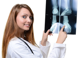 nice young female doctor looking at X-ray image