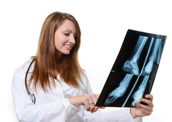 Young female doctor checking an x-ray image