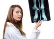 pretty female doctor looking at X-ray image