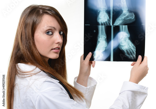 nice female doctor looking at X-ray image