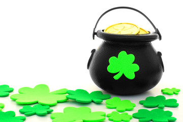 St Patrick's Day pot of gold with scattered shamrocks