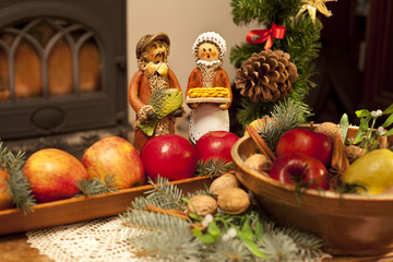 Xmas composition with figures, apples and needles