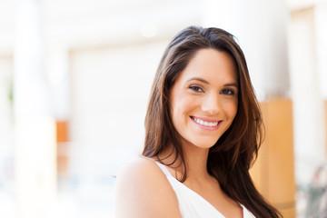 cute young woman in modern shopping center