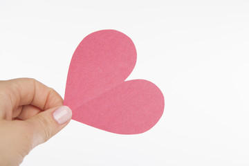 Hand Holding PInk Cut Out Heart
