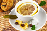 Cup of tea with lemon and cakes