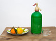 fruits tangerine and pear in vintage dish soda bottle