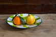 fruits tangerine and pear in vintage porcelain dish plate retro