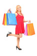 Full length portrait of a mature woman posing with shopping bags