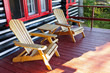 Log cabin porch with chairs