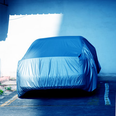 car with cover sheet
