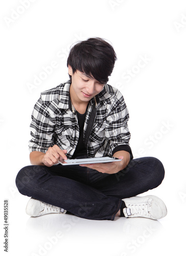 young man happy using tablet pc