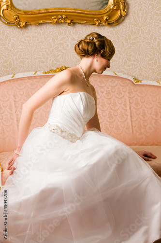 Bride and pink couch