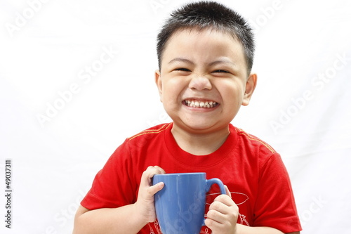 Little Boy Holding Mug