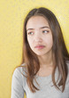 Multiracial attractive young woman looking sad
