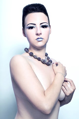 beautiful alien woman brunette with beads on the neck