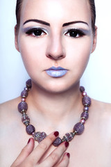 beautiful alien woman with beads on the neck and black eyes
