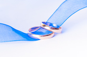 Golden wedding rings on the ribbon