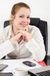 Portrait of beautiful business woman sitting in her office