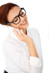 Woman in glasses chatting on a mobile