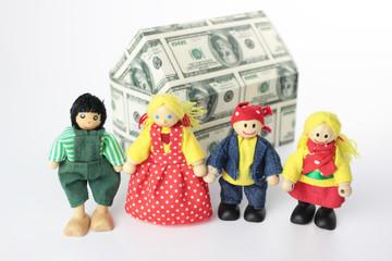 Familie vor Haus aus Dollarscheinen