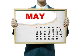 Business man holding board on the background, 2013 calendar