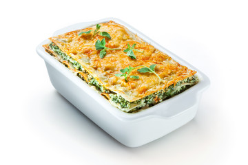 Spinach lasagna with basil. isolated. With clipping path
