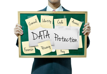 Business man holding board on the background, Data Protection