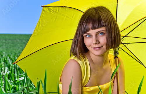 Young  girl with yellow umbrella