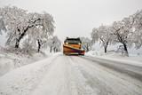 snow plow removes snow