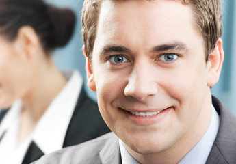 Portrait of smiling businessman at office