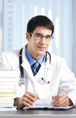 Writing doctor at office