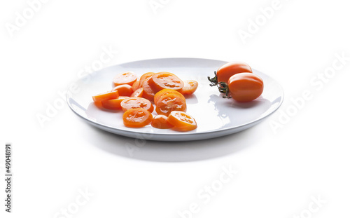 Sliced ​​tomato on a plate.