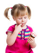 happy kid girl eating ice cream in studio isolated