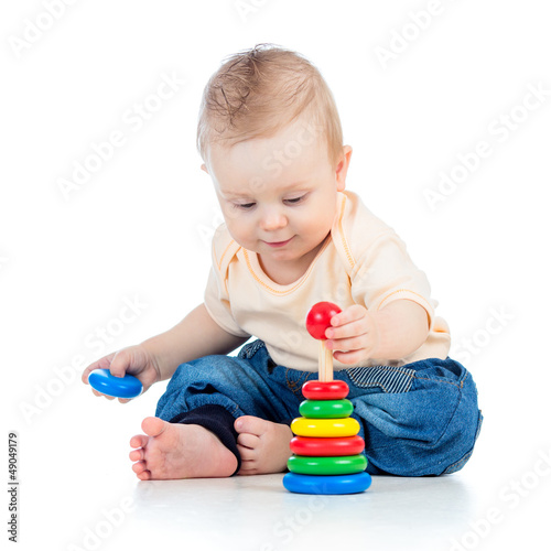 cute baby boy playing with colorful toy isolated on white backgr