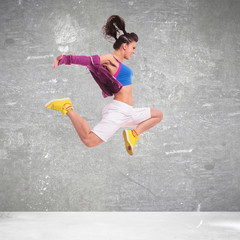 side view of a young woman dancer jumping