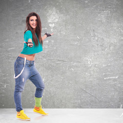 sporty woman dancer presenting something