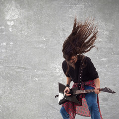 headbanging electric guitar player