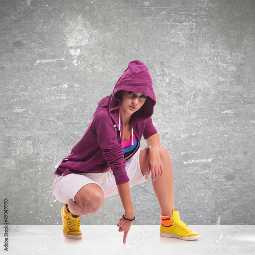 woman dancer wearing a hoodie