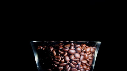 Grains of the roasted coffee in a glass. Horizontal view