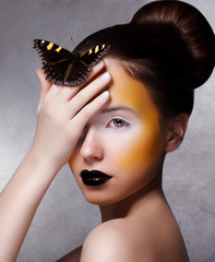 Trendy Woman with Butterfly. Creative Bright Make Up. Black Lips