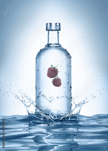 bottle with splashes and strawberries