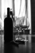 Glasses and wine bottle B&W image