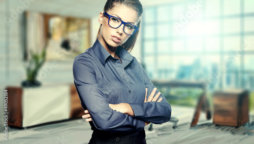 Closeup portrait of pretty cheerful business woman in an office