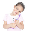 Little smiling girl holding a toothbrush