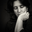 Black and white portrait ofa sad and depressed woman