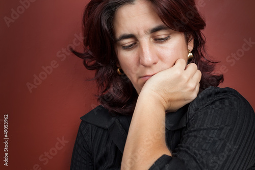 Portrait of a thoughtful and worried hispanic woman