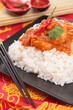 rice and red curry sauce
