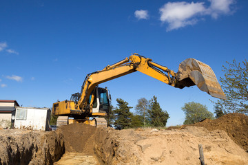 excavator digging sewer trenche