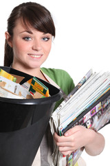 Young woman recycling paper